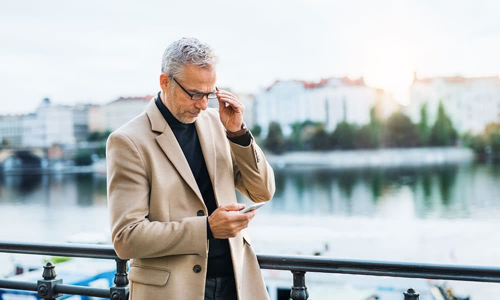 Man Checking Mobile Phone